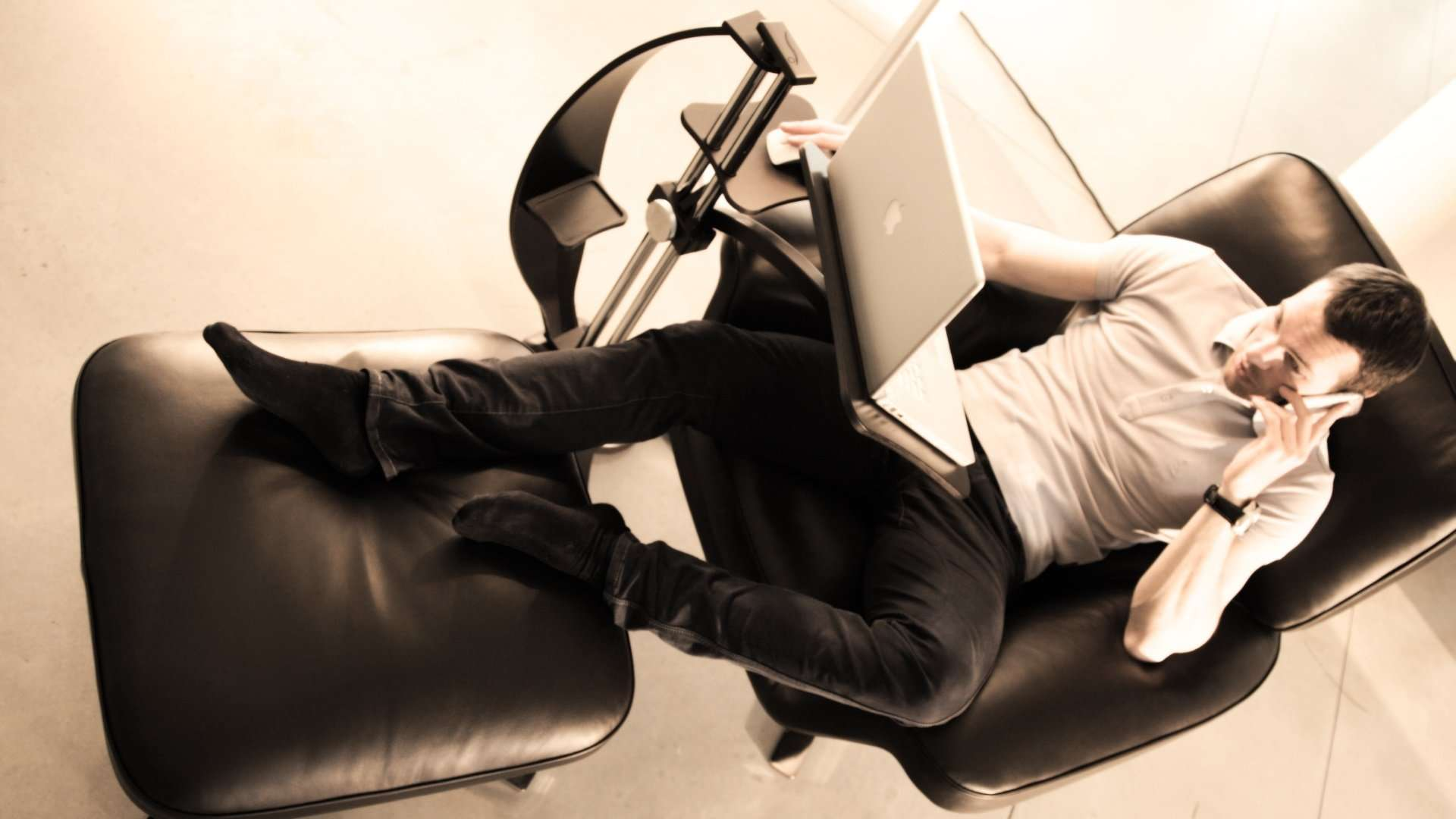 Ergonomic furniture. Comfort using laptop and tablet PC with a fully adjustable table.